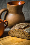 Still life with homemade bread and pottery Stock Image