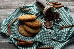 Still-life homemade cookies coffee beans, orange slices, cinnamon. On wood royalty free stock photo