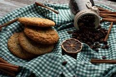 Still-life homemade cookies coffee beans, orange slices, cinnamon. On wood stock images
