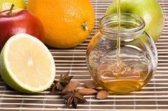 Still life of honey. And fruits royalty free stock photos