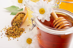 Still life with honey, flowers and pollen Royalty Free Stock Photos