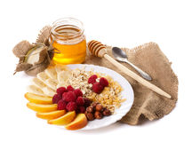 Still life with honey, fruits nuts and flakes Royalty Free Stock Photos