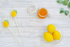 Still life with honey and lemons Royalty Free Stock Images