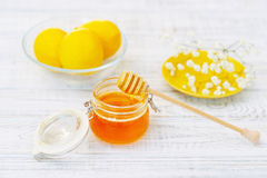 Still life with honey and lemons Stock Photos