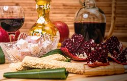 Still-life with Hookah, wine, garnet and sweets Stock Image