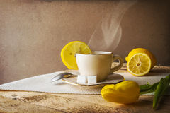 Still life hot cup of tea lemons Stock Photo