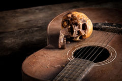 Still life with human skull on guitar Stock Images