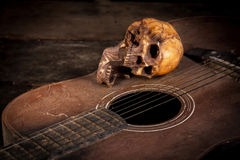 Still life with human skull on guitar Royalty Free Stock Images