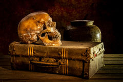 Still life with a human skull with old treasure chest and gold,. Diamond and jewelry on wooden background stock photography