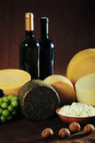 Still life image of natural cheese and wine Royalty Free Stock Photo