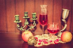 Still life image of red wine and fruits. Over wooden background Stock Photos