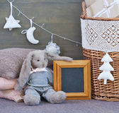 Still life with interior Christmas decoration elements and rabbit toy Royalty Free Stock Image
