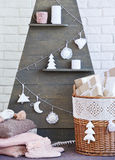 Still life with interior Christmas decoration elements and wooden tree Royalty Free Stock Photos