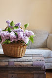 Still life interior details, bouquet of lilac in basket on trunk Stock Photo