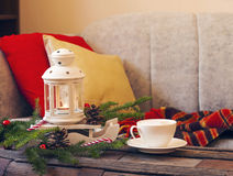 Still life interior details, cup of coffee, candles and Christmas decoration Stock Image