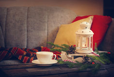 Still life interior details, cup of coffee, candles and Christmas decoration Royalty Free Stock Photo