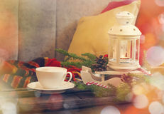 Still life interior details, cup of coffee, candles and Christmas decoration Stock Photos