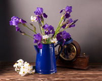Still life with iris. Es and daffodils on wooden table Royalty Free Stock Photo