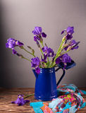 Still life with iris. Es on wooden table. Spring time flowers Royalty Free Stock Image