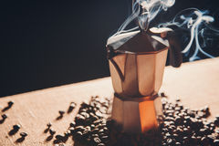 Still life with Italian coffee maker and roasted coffee beans Royalty Free Stock Photo