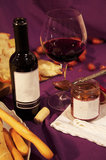 Still life with Italian gastronomic products. Breadsticks, wine and shallot Royalty Free Stock Photos