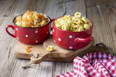 Still life Italian pasta. Tortellini in the form of hearts on a cutting board with olive tree Royalty Free Stock Photography