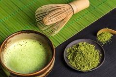 Still life with Japanese matcha tea. Still life with Japanese matcha accessories and green tea in bowl royalty free stock image