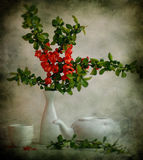 Still life with the japanese quince and tea-pot Stock Photo