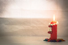 Still life Jasmine garlands on red candle and incense cone in wa Royalty Free Stock Image