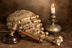 Still life with judge's wig. Still life with candle, judge's antique wig and gavel stock photos