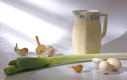 Still-life with a jug, an onions Royalty Free Stock Photo