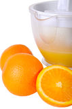Still life with a juice extractor and oranges stock photography