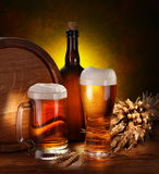 Keg of beer. And draft beer by the glass royalty free stock photo