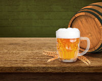 Still Life with a keg of beer and beer in the mug. Placed on a wooden table frothy beer, wheat beer keg photo Stock Photos