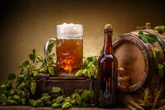 Keg of beer. Still life with a keg of beer, decorated with hops Royalty Free Stock Images