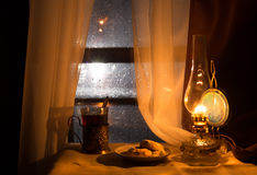 Still life with kerosene lamp Stock Images