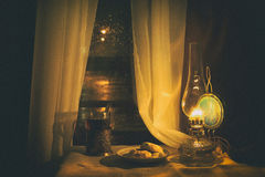 Still life with kerosene lamp Stock Photos