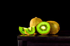 Still life, Kiwi fruit on the table and black background, lowkey Royalty Free Stock Image