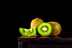 Still life, Kiwi fruit on the table and black background, lowkey Royalty Free Stock Image