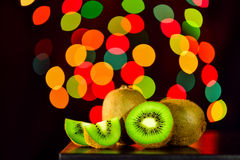 Still life, Kiwi fruit on table with bokeh background, lowkey Royalty Free Stock Photo