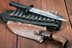 Still life with a knife and bandolier Stock Images