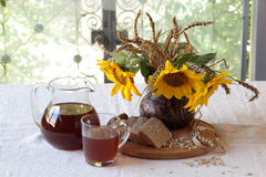 Still-life with kvass (kvas) in a transparent jug and a bouquet Royalty Free Stock Photo