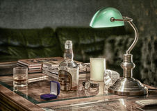 Still life with lamp and alcohol Stock Photography