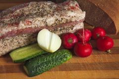 Still life with lard, bread. And vegetables Royalty Free Stock Photography