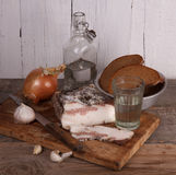 Still-life with lard and vodka Stock Photography