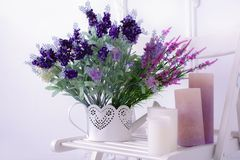 Still life of lavender flower and candles on a white chair close view Royalty Free Stock Photos