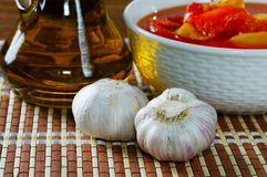 Still Life with lecho garlic and  oil Royalty Free Stock Photo