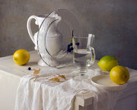 Still life with lemons and white pitcher Stock Photo