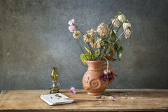 Still life of the letter and flowe. Still life Photography with the letter and flower on wooden table and dark grunge background Royalty Free Stock Photo