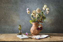 Still life of the letter and flowe. Still life Photography with the letter and flower on wooden table and dark grunge background Royalty Free Stock Images